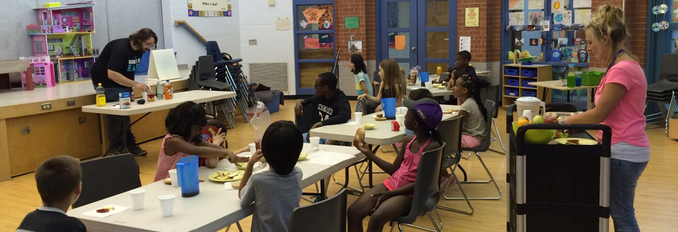 Students attending a breakfast club in a classroom