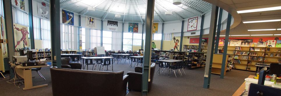 Learning Commons area of the school with books and tables